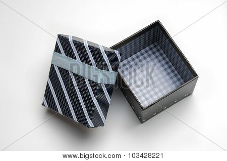 Open Black Gift Box With Ribbon And Blue Lines Top