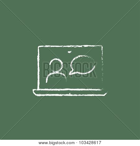 Video chat online hand drawn in chalk on a blackboard vector white icon isolated on a green background.