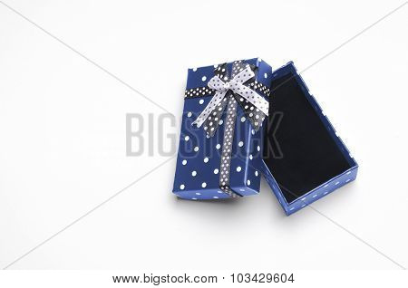 Small Open Blue Gift Box With Ribbon And Circles Top