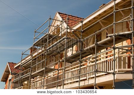 Scaffolding On A House  Under Blue Sky
