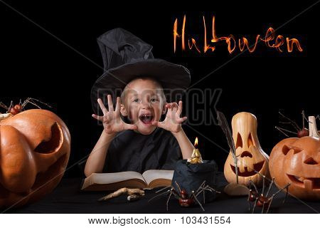 Child, Halloween pumpkin, magical things  on black background