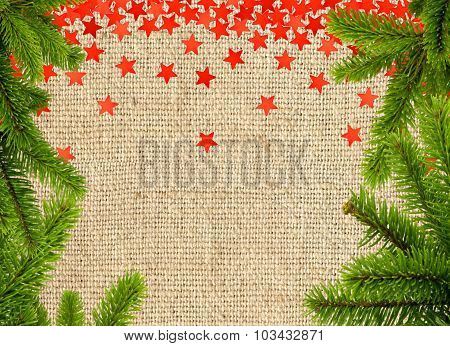 Red Stars And Christmas Tree Branch On Linen Texture Background