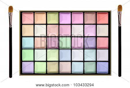 Set Of Pastel Eyeshadows And Brushes Isolated On White Background