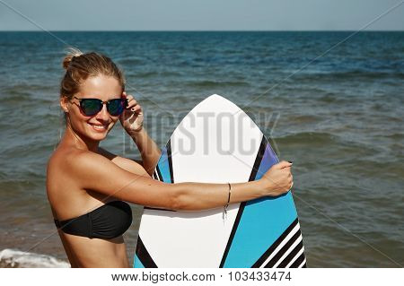 Portrait Of Beautiful Blond Active Woman Spending Summer Holidays On The Beach, Enjoying Kite Board