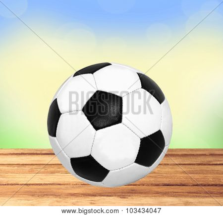 Soccer (football) Ball On Wooden Table Over Nature Background