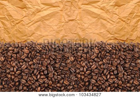 Close-up Of Roasted Coffee Beans Over Old Yellow Paper