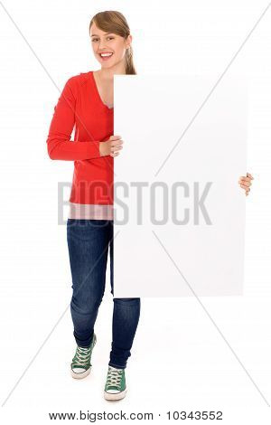 Young woman holding blank poster