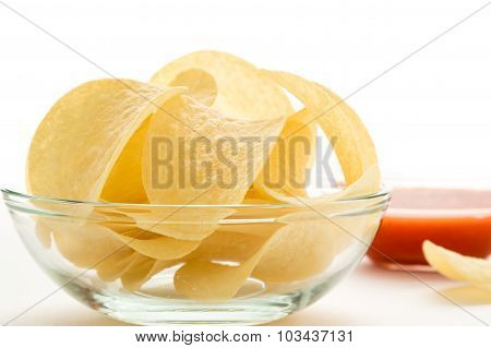 Potato Chips In A Glass Bowl With Dip
