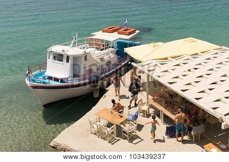 Paros, Greece, 10 August 2015. Arrival of  a boat with passengers at famous Arodo beach in Paros.