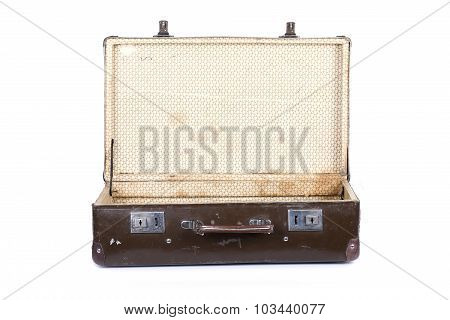 Old open suitcase isolated on white background