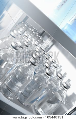 Medical Solutions In Bottles Standing In Warehouse