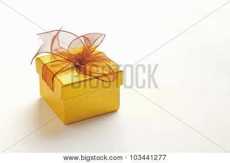 Golden Gift Box With Brown Tie