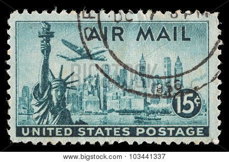 United States Air Mail Postage Stamp Showing An Airplane Over New York Skyline And The Statue Of Lib