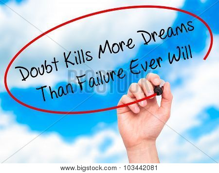 Man Hand writing Doubt Kills More Dreams Than Failure Ever Will with black marker on visual screen.