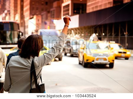 NEW YORK CITY, USA - CIRCA SEPTEMBER 2014: Woman waving for taxi in New York City