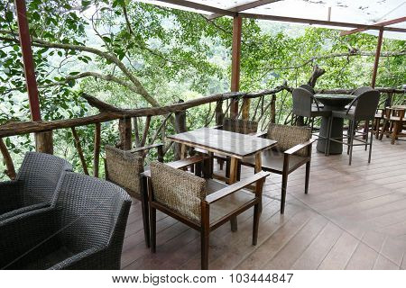 Rattan And Wooden Chair And Desk On The Terrace