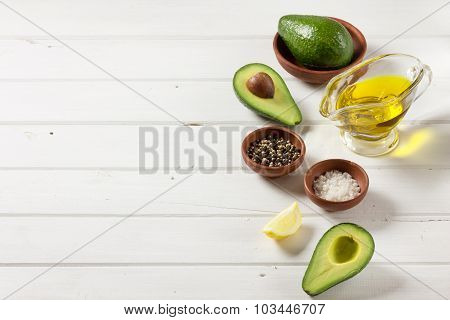 Avocado, and other ingredients for sauce guacamole on the table.