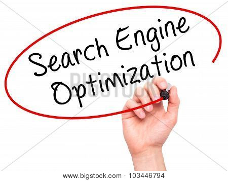 Man Hand writing Search Engine Optimization with black marker on visual screen.
