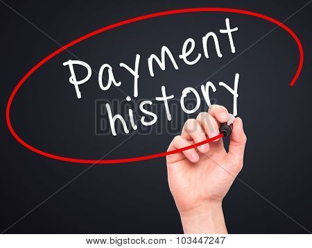 Man Hand writing Payment history with black marker on visual screen.