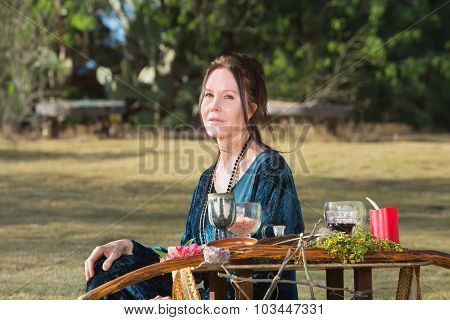 Pagan Woman Sitting Outdoors