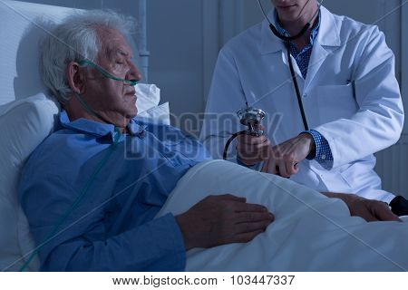 Asleep Old Patient Being Examined