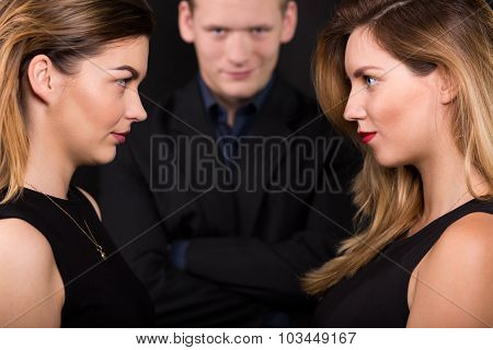 Two Alluring Women And Man
