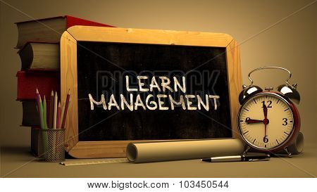 Learn Management - Chalkboard with Hand Drawn Text.