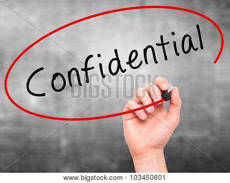 Man Hand writing Confidential with black marker on visual screen.