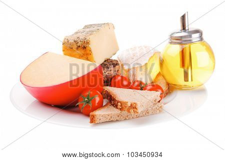image of cheeses and olive oil on plate