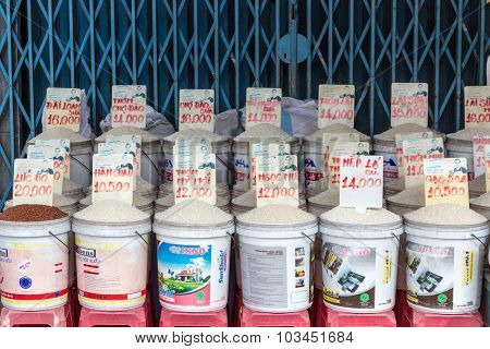 CAN THO, VIETNAM, DECEMBER 11, 2014 : A stall of a wide collection of different rices varieties in the street market of Tan An in Can Tho, Vietnam