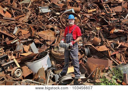 Recycling Industry, Worker Stand At Heap Of Old Metal