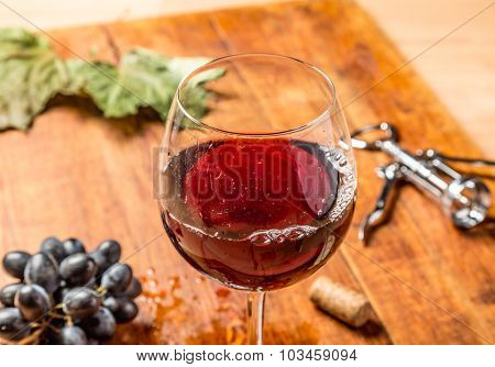 Closeup of red wine pouring in glass.