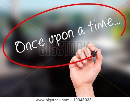 Man Hand writing Once upon a time... with black marker on visual screen