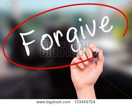 Man Hand writing Forgive with black marker on visual screen.