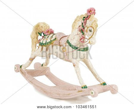 Vintage rocking horse isolated on white background with shadow