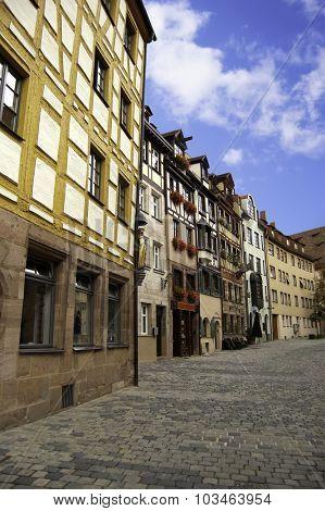 Quiet traditional European cobblestone alleyway in Nuremberg, Germany