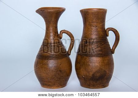 Two Brown Ceramic Jug