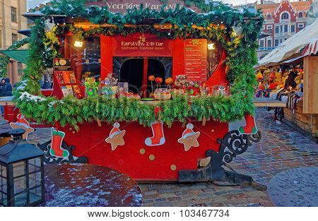 Christmas Market Stall With Traditional Seasonal Treats In Old Riga