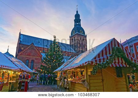 Group Of Unidentified People Christmas Market At Dome Square In Old Riga