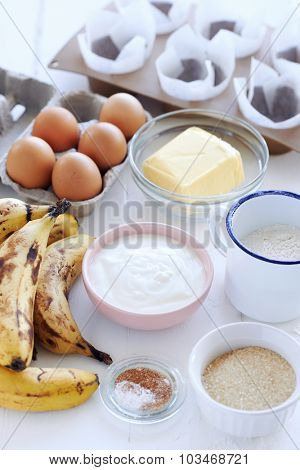 Baking ingredients laid out for a banana cake muffin healthy snack