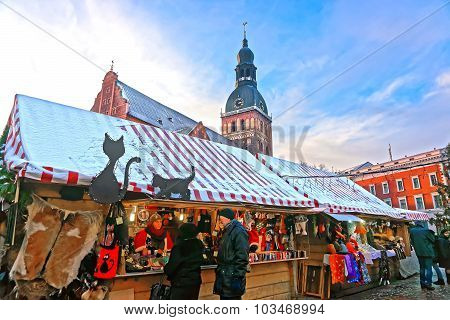 People Buying Traditional Souvenirs At Christmas Market In Riga