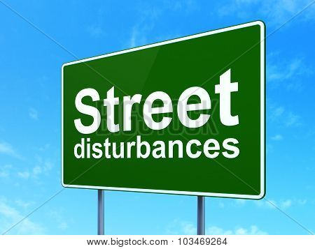 Politics concept: Street Disturbances on road sign background