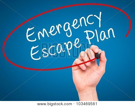 Man Hand writing Emergency Escape Plan with black marker on visual screen.