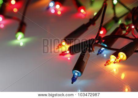 Closeup of Christmas lights glowing
