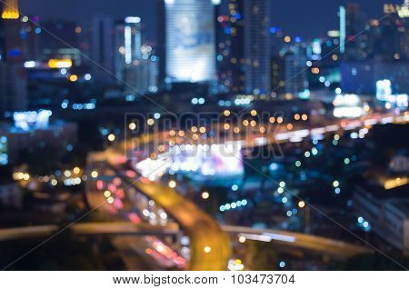 City intersection road, abstract blurred bokeh light at night