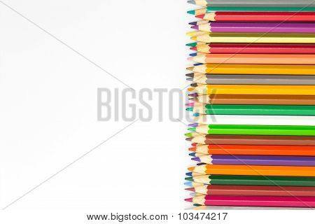Colours wooden pencils on white background