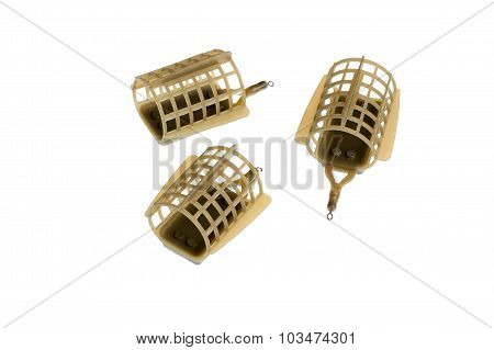 Three Feeders For Fishing On A White Background