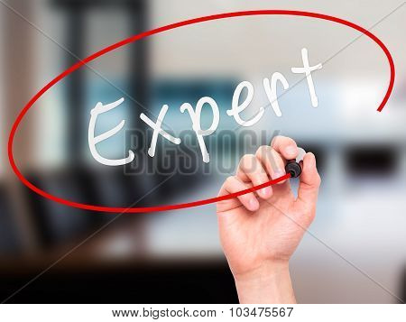 Man hand writing Expert on visual screen.