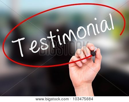Man hand writing Testimonial on visual screen.