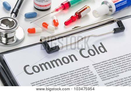 The Diagnosis Common Cold Written On A Clipboard